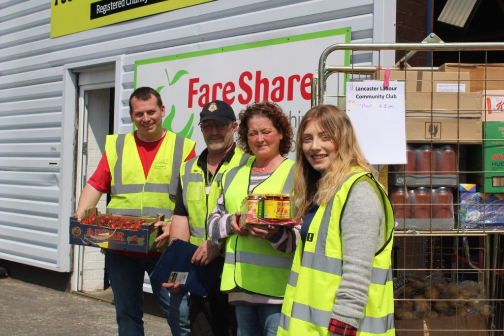 Volunteers from Lancaster Community Club collecting surplus food at FareShare Lancashire and Cumbria