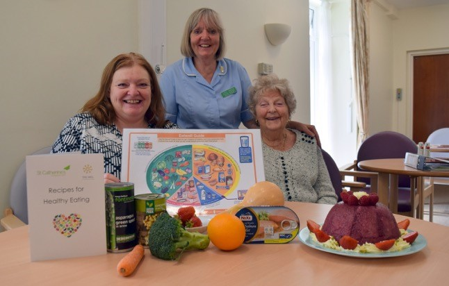 Staff at St Catherine's Hospice with surplus food delivered to them by FareShare