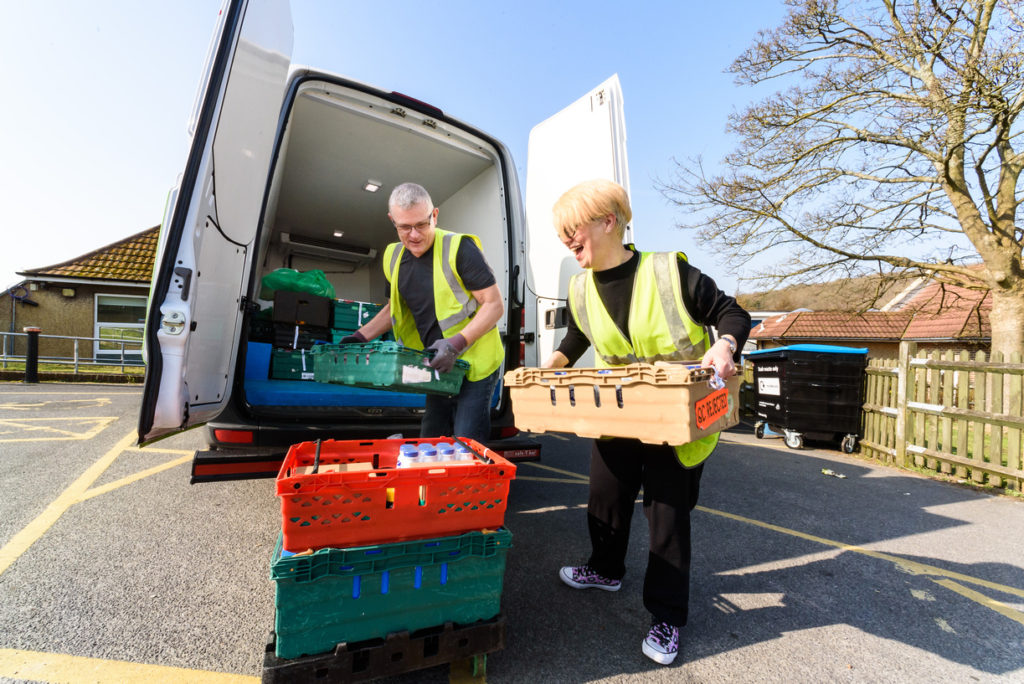 FareShare volunteers load up the van for a delivery of food to local charities and community groups.